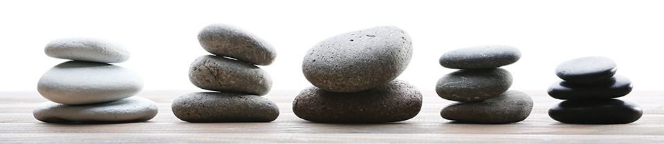 Image of stones used in Hot Stone Therapy. Use of the stones enhances the effectiveness clinical massage in certain circumstances