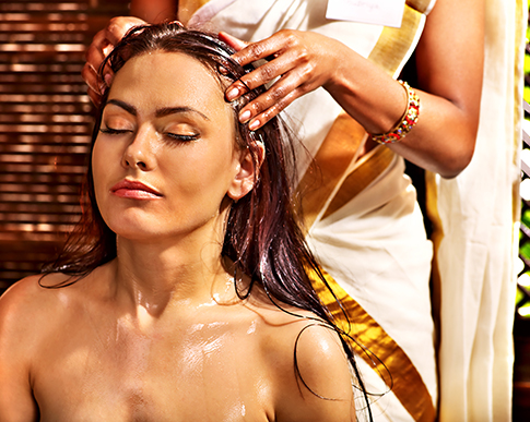 Image of woman receiving Indian Head Massage. Lesley Cook is a qualified Indian Head Massage practitioner.