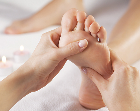 Image of a foot during a Reflexology treatment. Lesley Cook is a qualified member of the Associatio of Reflexologists